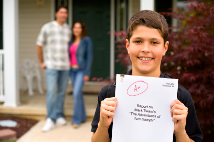 Boy-holding-report-card