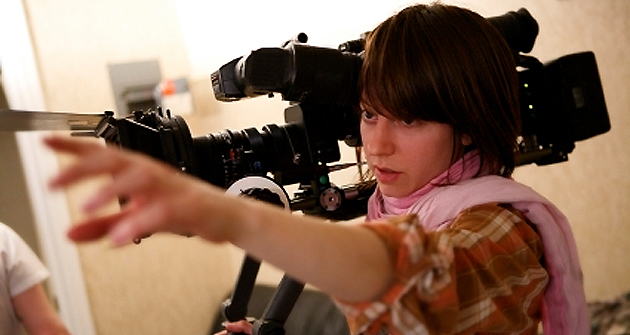 A young woman directing the crew on set.