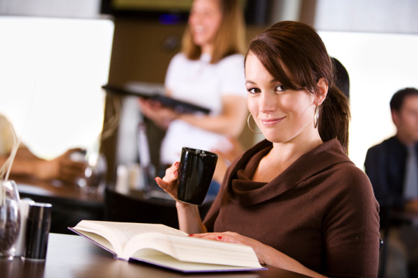 woman-at-cafe-reading-book